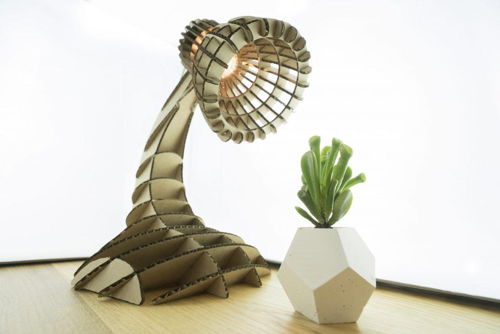 Cardboard lamp base from lasercut corrugated cardboard.