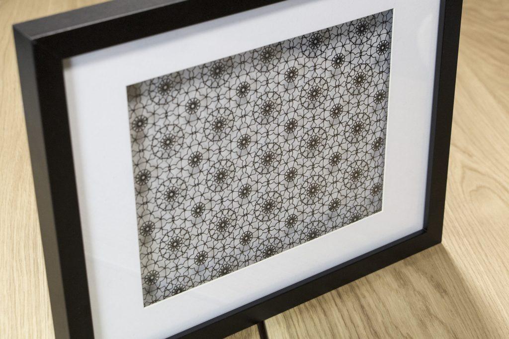 Intricate pattern cut from black card.