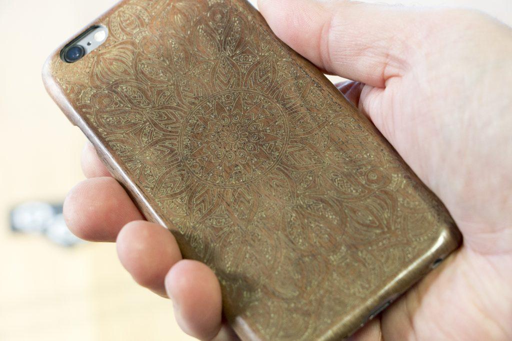 Laser engraved walnut iPhone case.